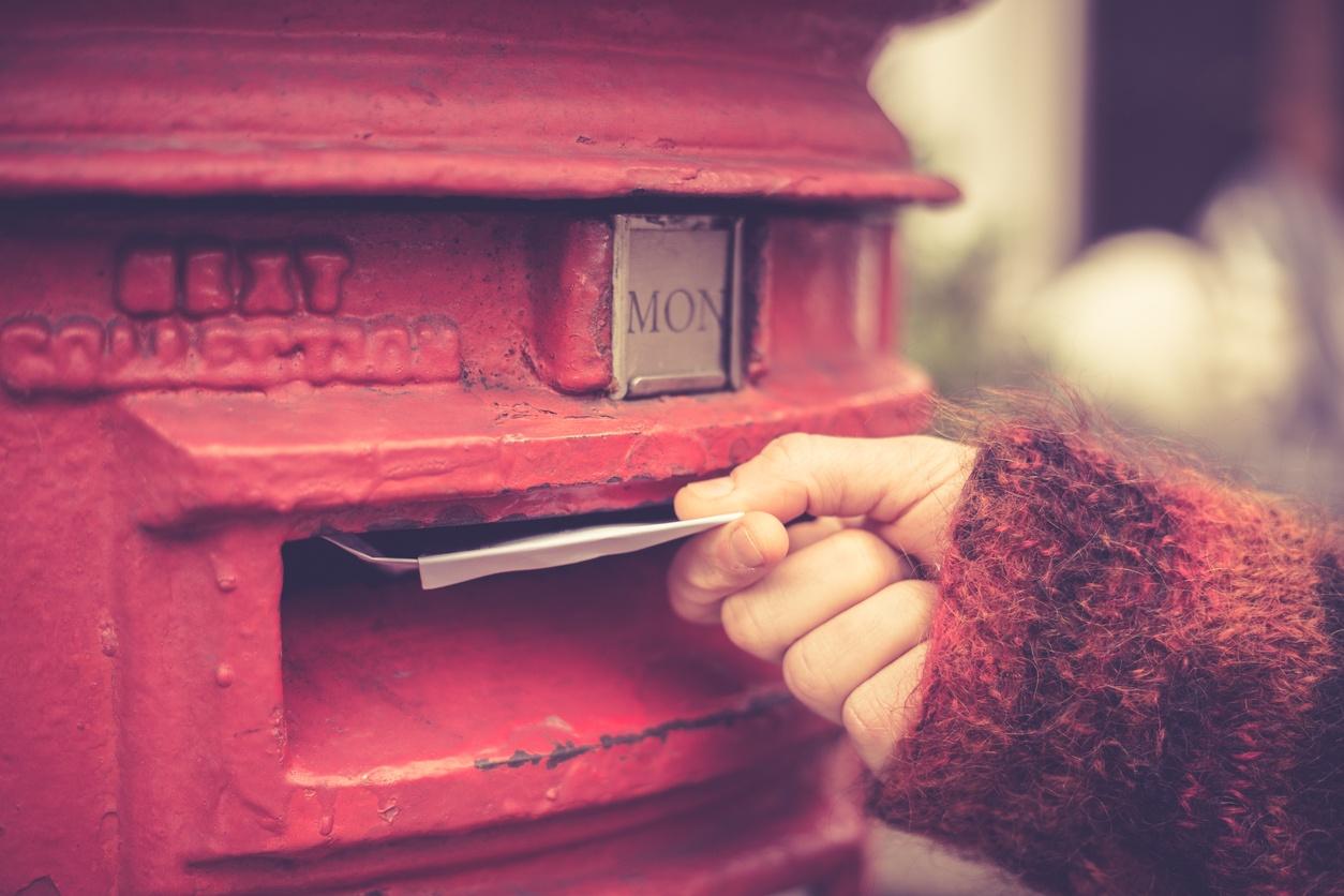 Woman-posting-letter-480312017_1255x837.jpeg